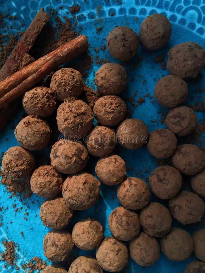 Delicious chocolate truffles in a blue plate royalty free stock photography
