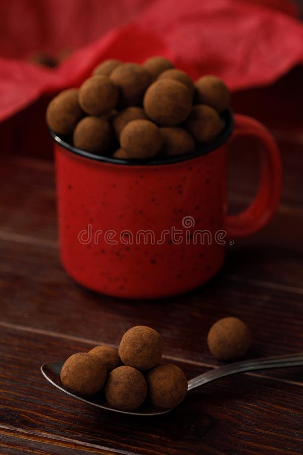 Delicious chocolate truffles in a red Christmas mug stock photos