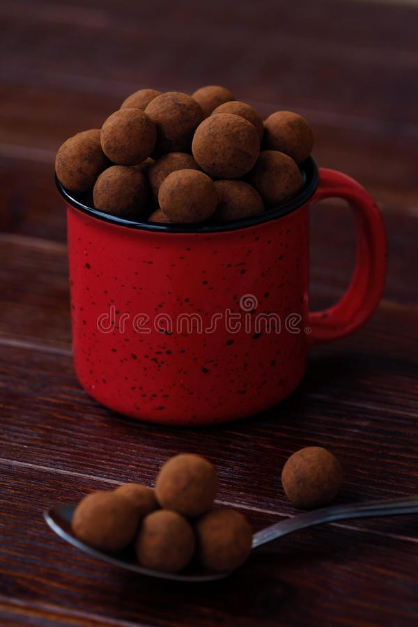 Delicious chocolate truffles in a red Christmas mug stock photography