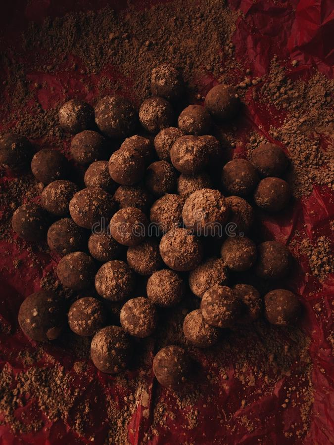 Delicious chocolate truffles in red paper view royalty free stock photo