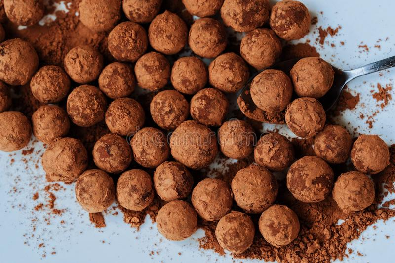 Delicious chocolate truffles in a white plate royalty free stock photography