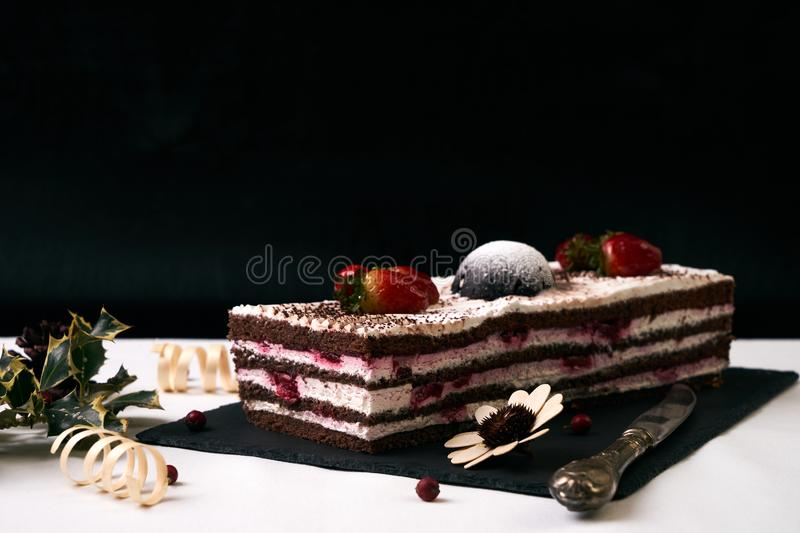 Delicious Christmas cake with fresh strawberries royalty free stock photography
