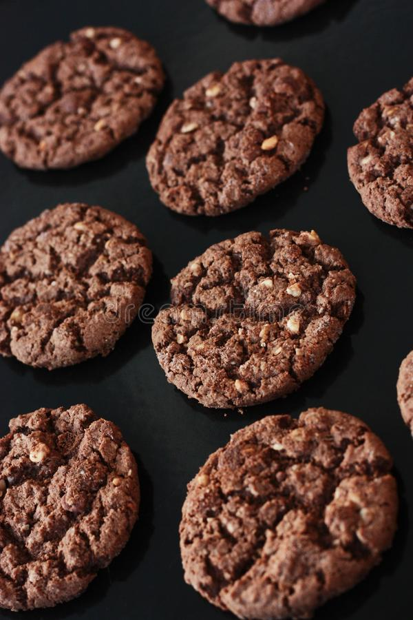 Delicious Christmas chocolate cookies with nuts for Breakfast royalty free stock image