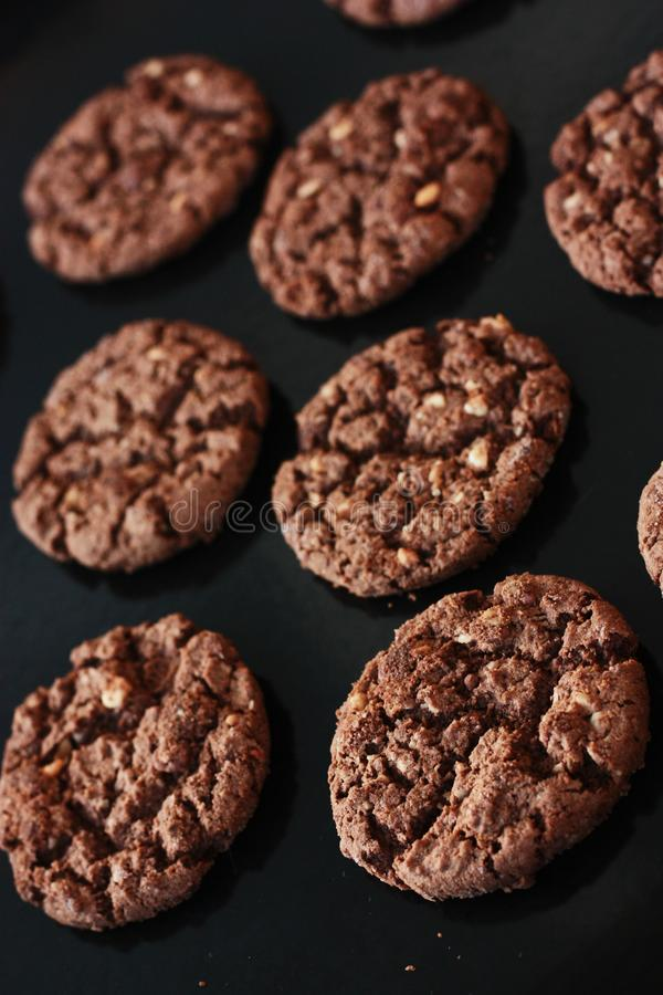 Delicious Christmas chocolate cookies with nuts for Breakfast stock photos