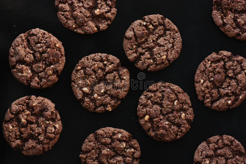 Delicious Christmas chocolate cookies with nuts for Breakfast stock photo