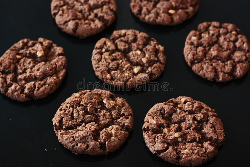 Delicious Christmas chocolate cookies with nuts for Breakfast royalty free stock photos