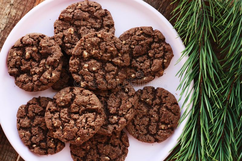 Delicious Christmas chocolate cookies with nuts close up royalty free stock images