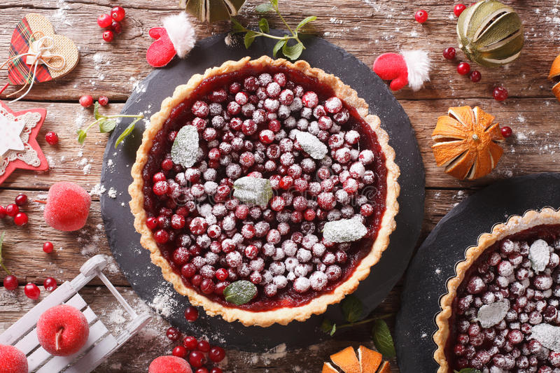 Delicious Christmas cranberry tart and festive decoration close-up. Horizontal top view stock image