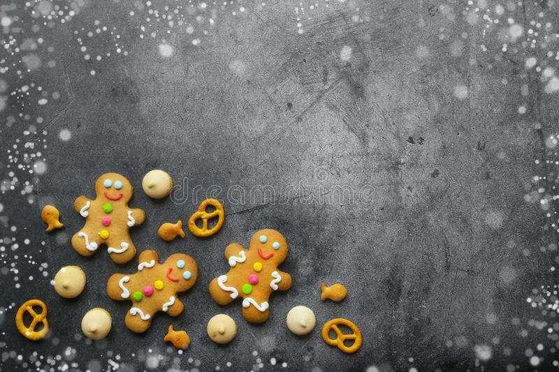 Delicious Christmas gingerbread men on dark background royalty free stock photos