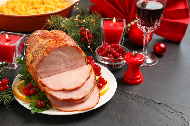delicious christmas ham served with garnish stock image