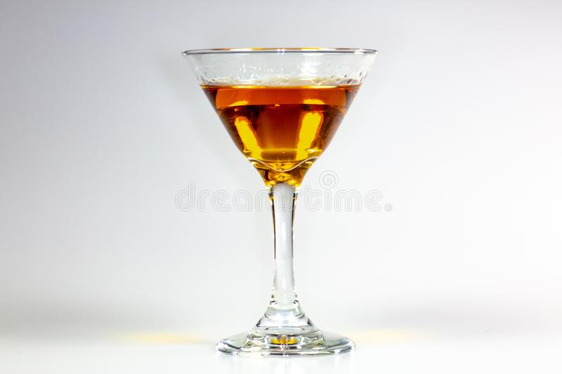 A delicious cocktail waiting on a white counter waiting to be consumed.  royalty free stock photo