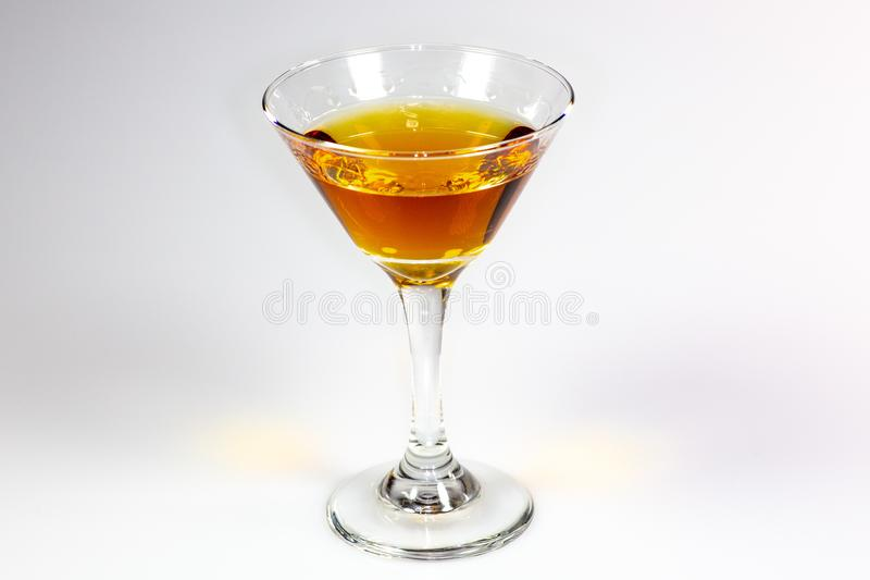 A delicious cocktail waiting on a white counter waiting to be consumed.  royalty free stock image