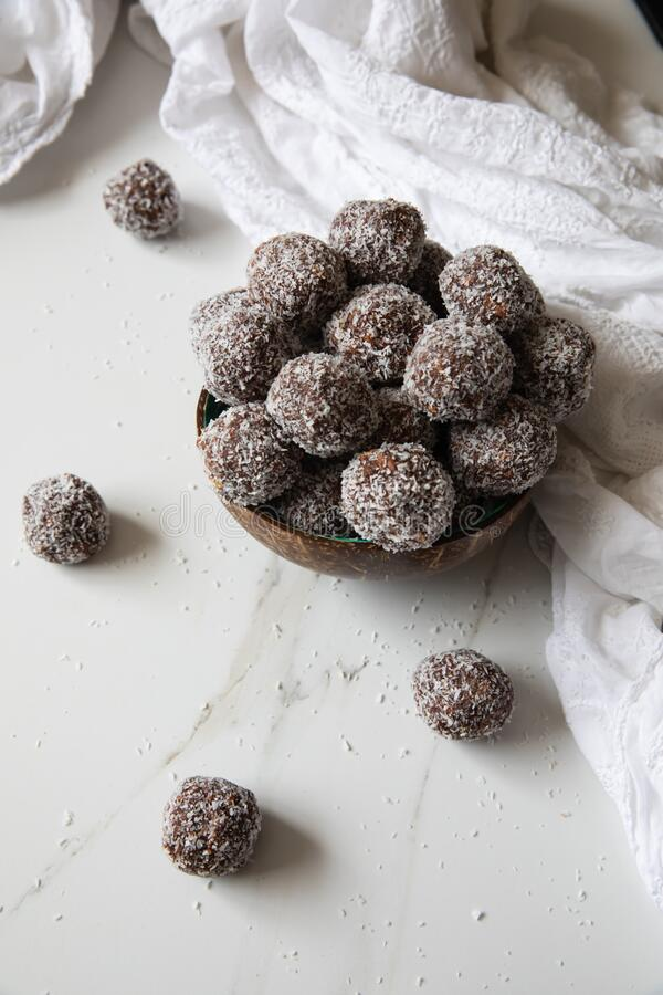Free Delicious Coconut-Chocolate Balls Covered With Grated Coconut Served In A Coconut Plate Against White Background Royalty Free Stock Images - 178780329