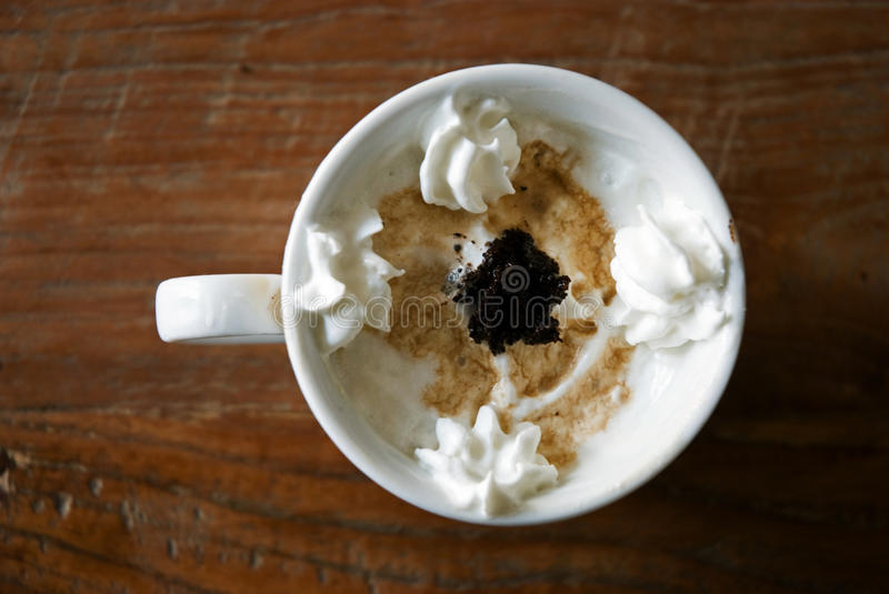 Delicious coffee with cream royalty free stock photography