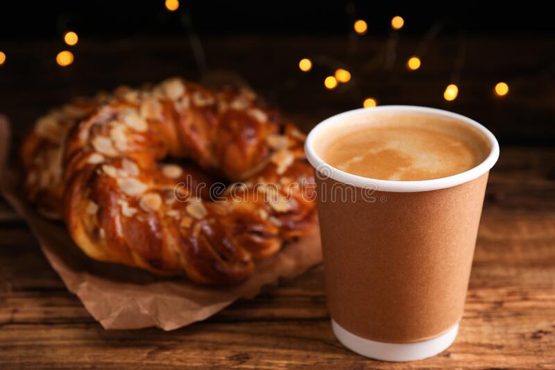 Delicious coffee and pastries. On wooden table stock photo