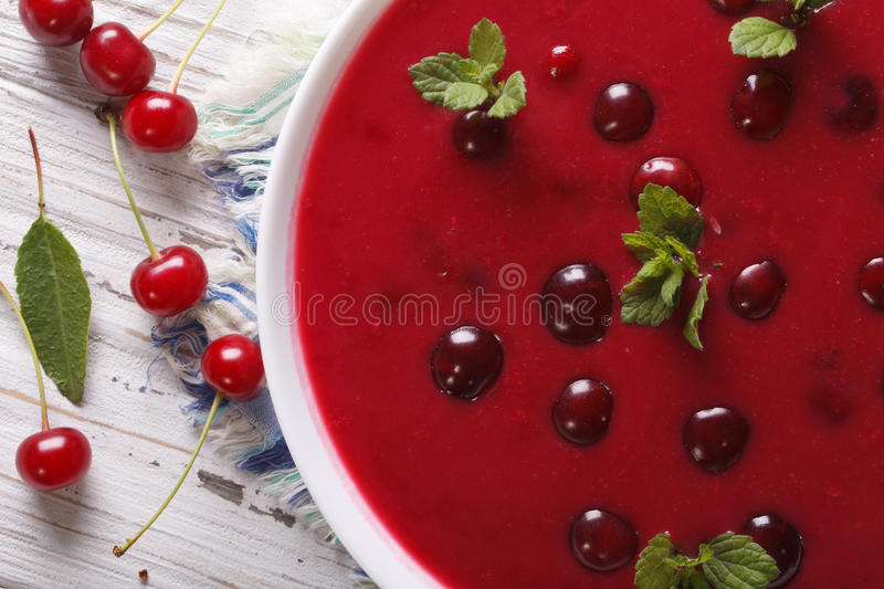 Delicious cold cherry soup in a bowl macro. Horizontal top view. Delicious cold cherry soup in a bowl on a table macro. horizontal top view stock photo