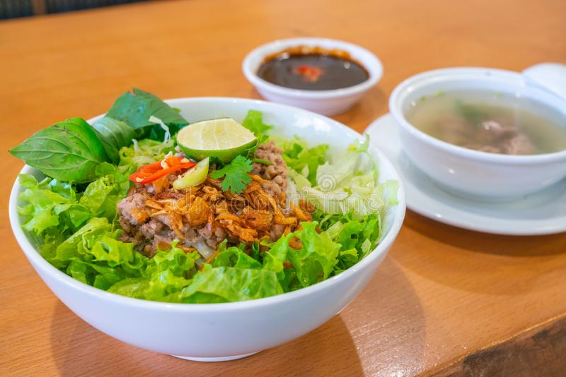 Delicious and colorful bowl of traditional Vietnamese pork noodle soup. Delicious and colorful bowl of traditional pork noodle soup in Asian restaurant royalty free stock photo