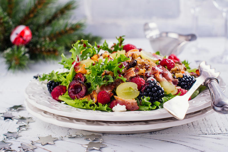 Delicious colorful salad for Christmas dinner royalty free stock photos