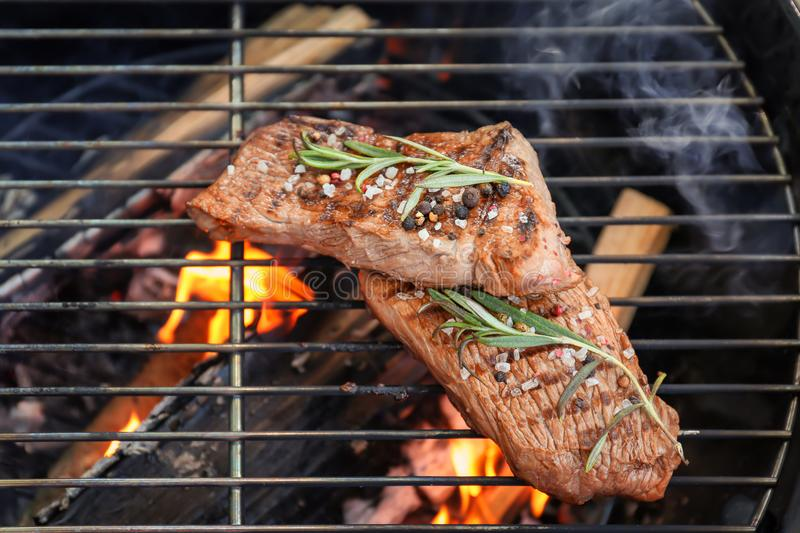 Delicious cooked meat. On grill royalty free stock images