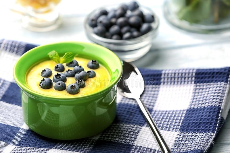 Delicious cornmeal porridge with blueberry. On napkin royalty free stock images