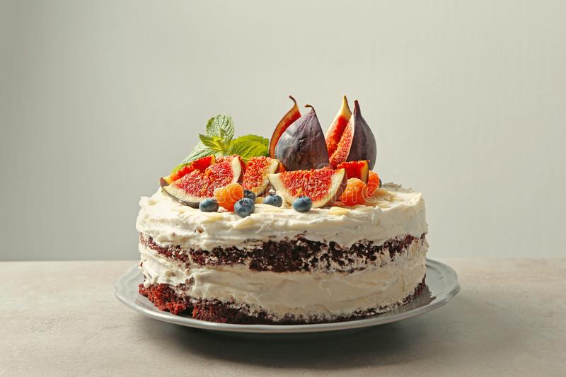 Delicious creamy cake with figs and berries royalty free stock photos