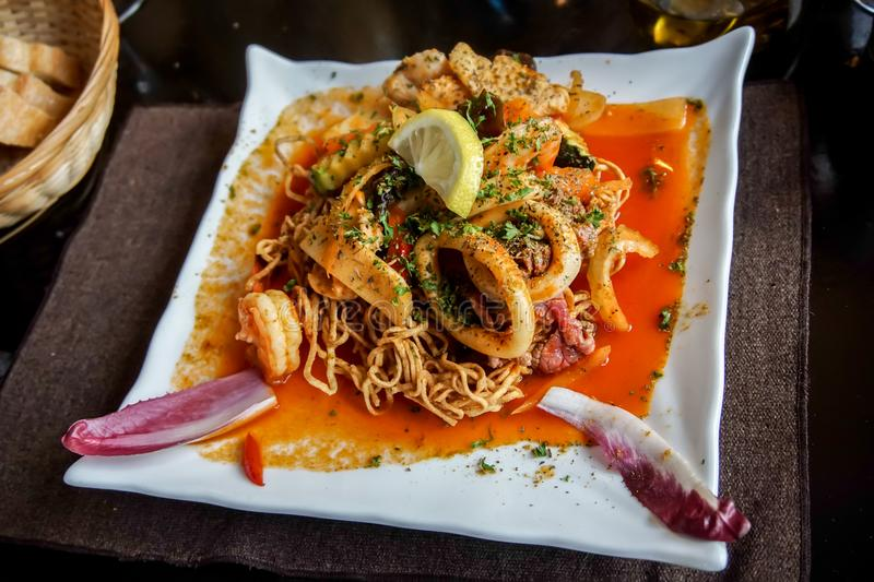 Crispy Chinese noodle dish with seafood, fish, prawn, squid stock photography