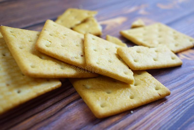 Delicious crumbly cracker. Delicious crumbly cracker on wooden background.Cookies for tea stock photos