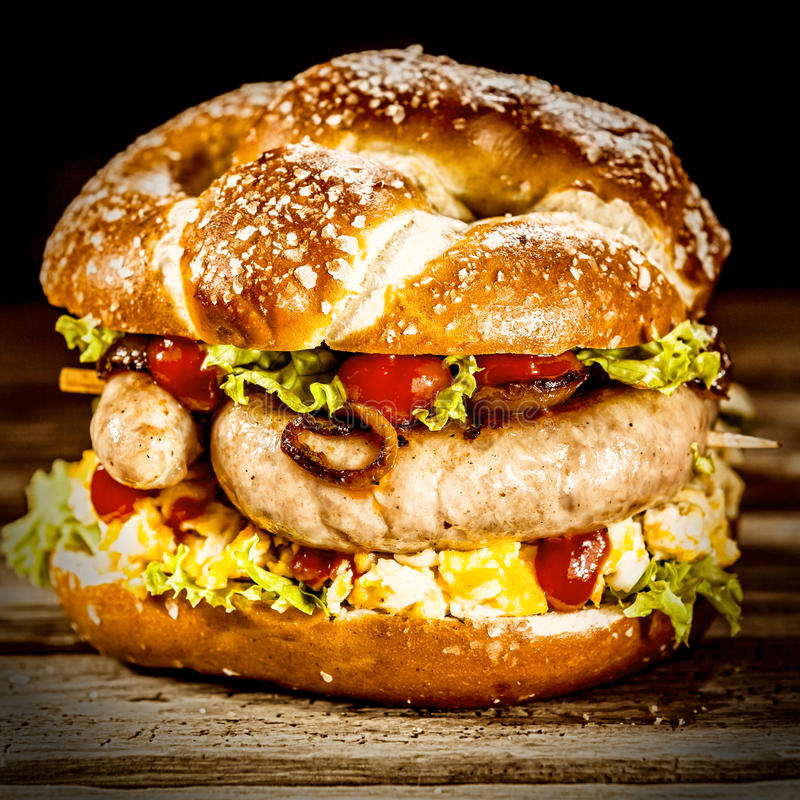 Delicious crusty burger with German sausage royalty free stock photography