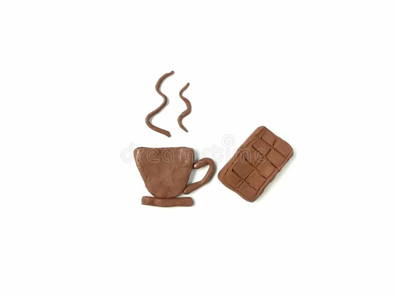 Delicious hot drink, chocolate bar plasticine clay, cute shaped dough royalty free stock image