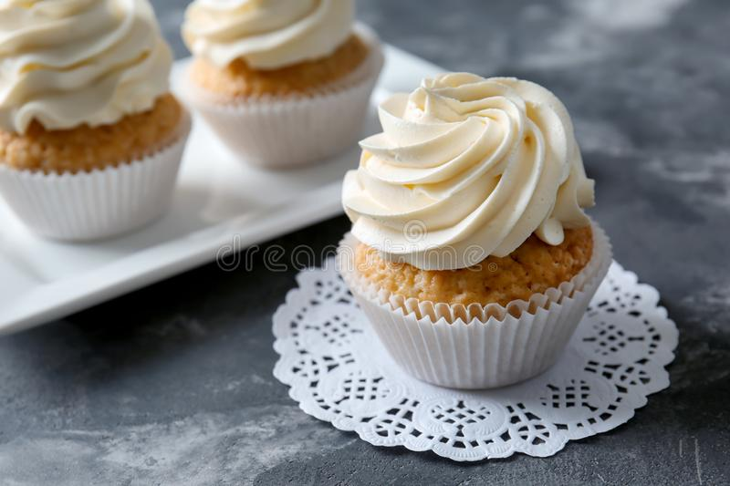 Delicious cupcake on grey table royalty free stock image