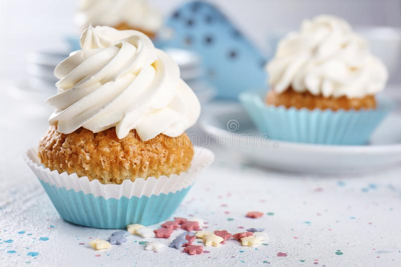 Delicious cupcake on light table royalty free stock photography