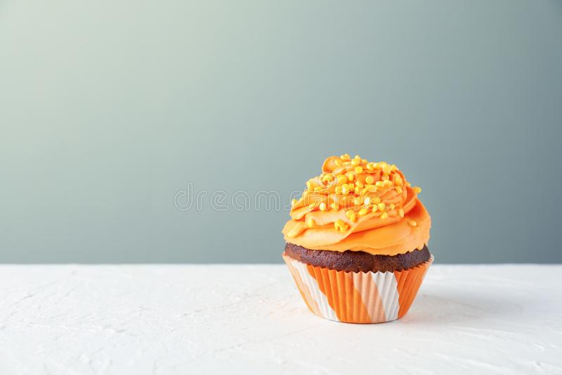 Delicious cupcake on white table stock photo
