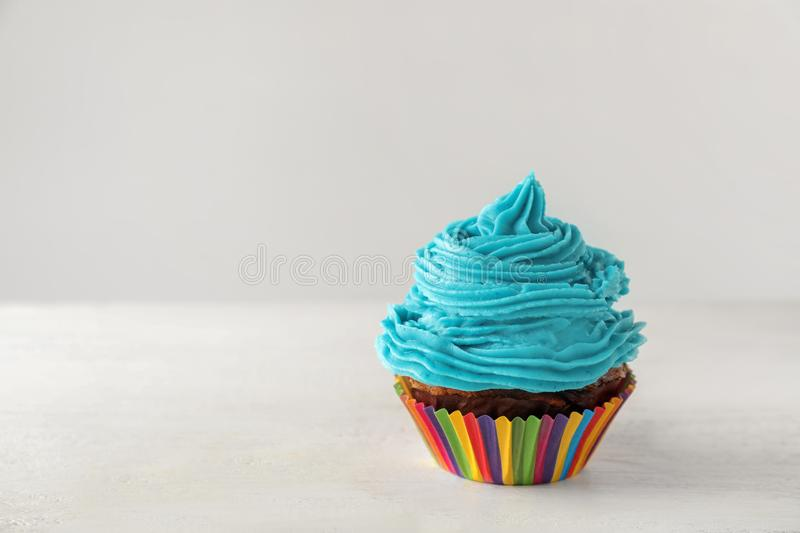 Delicious cupcake on white table stock photography