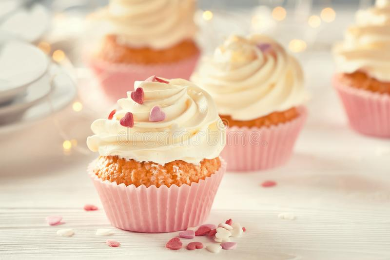 Delicious cupcake on white table royalty free stock photography