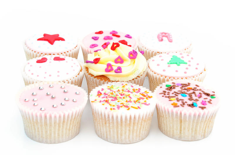 Delicious cupcakes. Some home made delicious cupcakes in a row royalty free stock photo