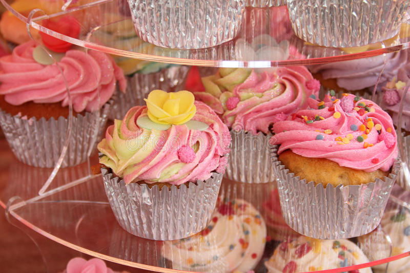 Delicious cupcakes. Delicious decorated cupcakes in silver cases royalty free stock images