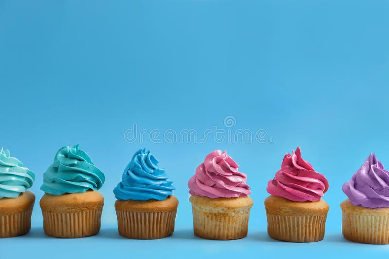Delicious cupcakes. On color background royalty free stock images