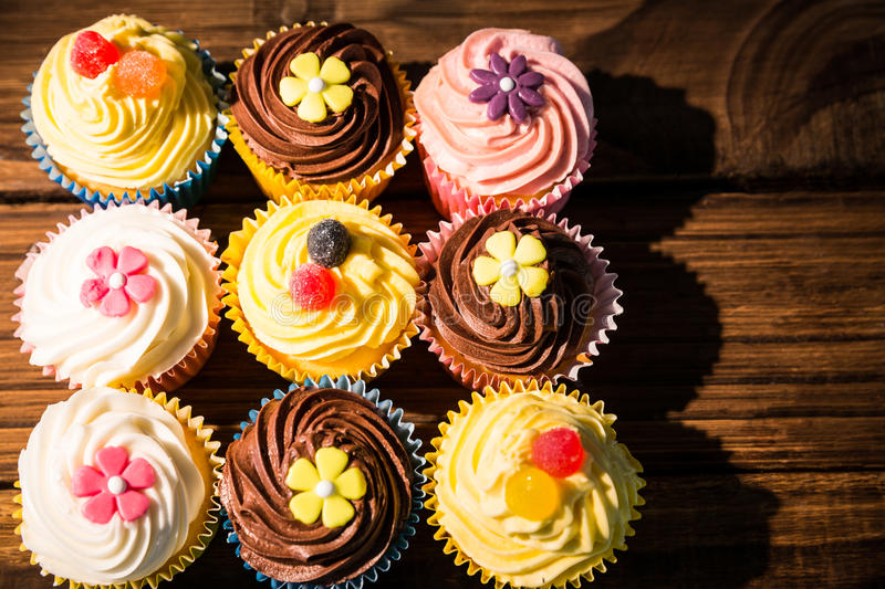 Delicious cupcakes on a table. Shot in studio royalty free stock photo