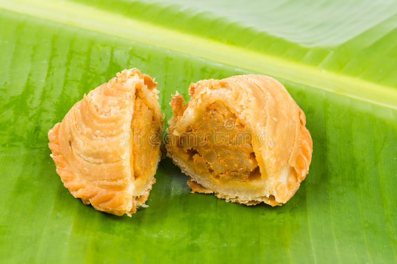 Delicious curry puffs with spicy sweet potatoes fillings royalty free stock image