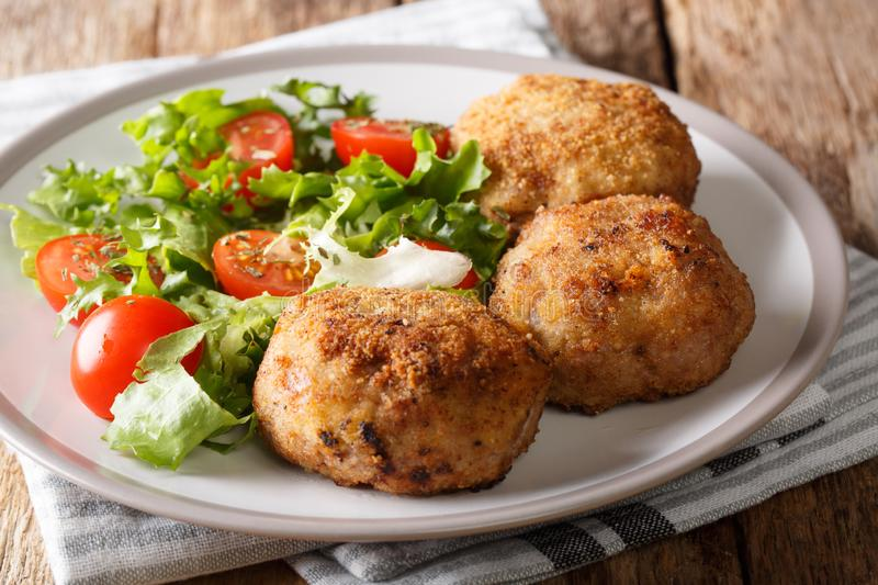 Delicious Danish food patties made from minced pork in breading. With fresh vegetable salad closeup on a plate on the table. horizontal royalty free stock photo