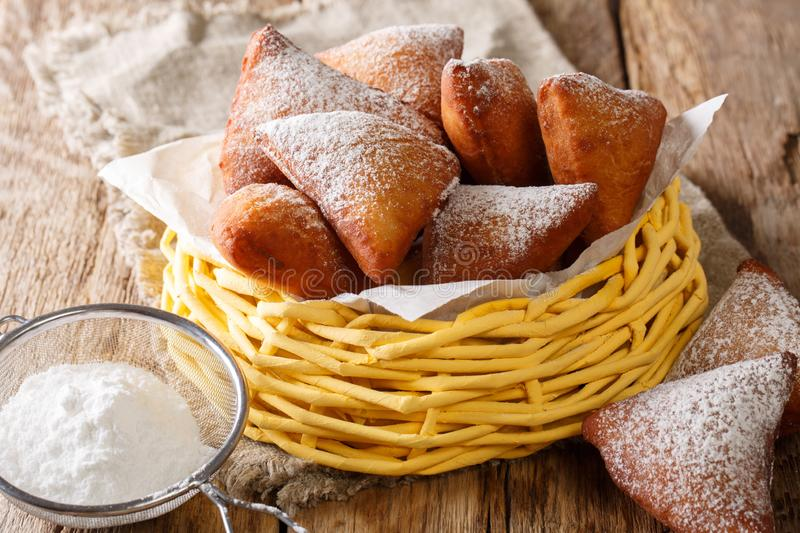 Delicious deep-fried donuts East African Mandazi with powdered s stock photo