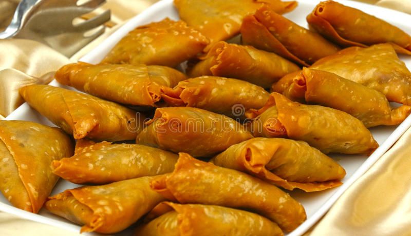 Delicious Deep fried south Indian Samosa pies on a white tray,-21 JULY 2017 royalty free stock image