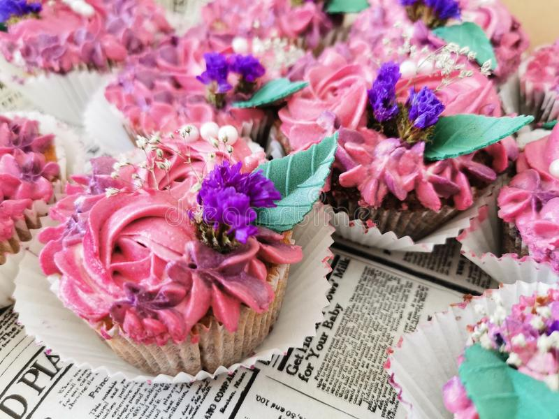 Delicious design cupcakes with flowers. Rose, purple, blue, green, leaf, leaves, creative, design royalty free stock photography