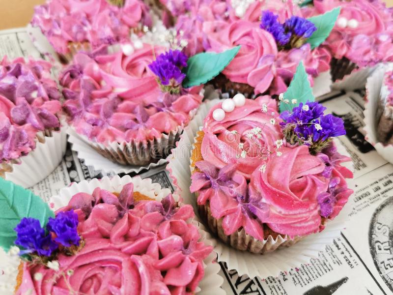 Delicious design cupcakes with flowers. Delicious, cupcakes, flowers, rose, purple, blue, green, leaf, leaves, creative, design stock photos