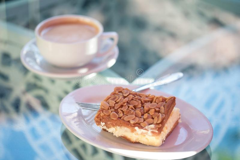 A delicious dessert: almond tart with cream, and a cup of a hot stock images