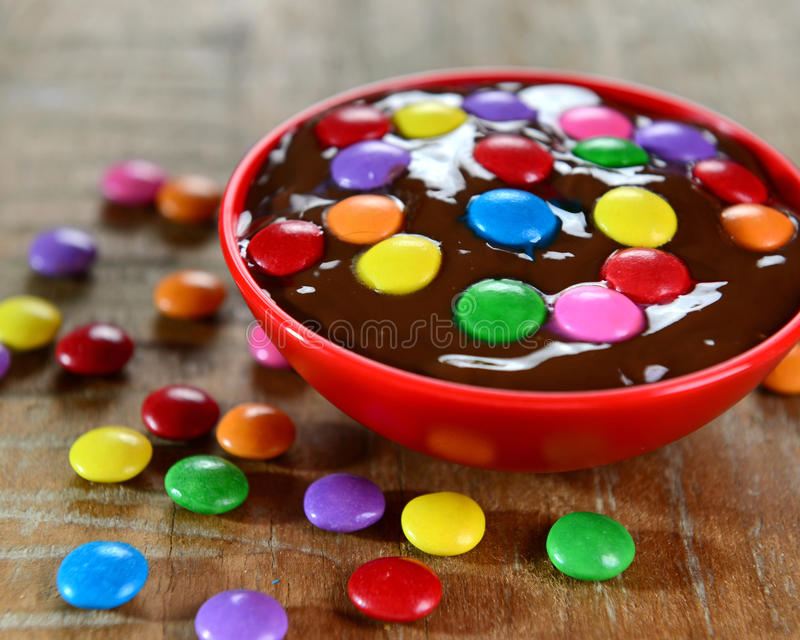 Delicious dessert. Chocolate sauce and colorful confettis stock photography