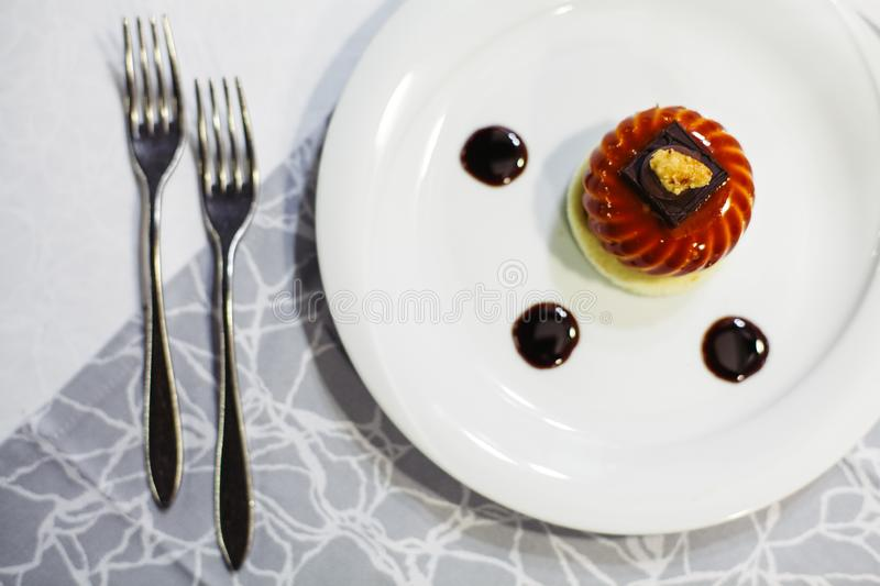 Delicious dessert in a restaurant. Background, bake, baked, bakery, berry, breakfast, brown, cafe, cake, chocolate, closeup, coffee, cooking, cream, cuisine royalty free stock photography