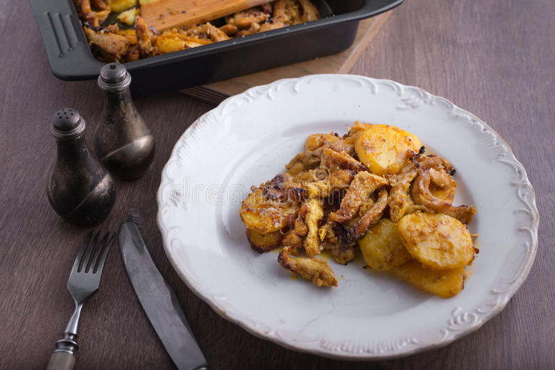 Delicious dinner chicken with potatoes stock photography