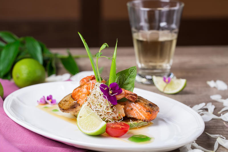 A delicious dish of grilled salmon royalty free stock photography