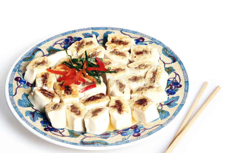 Delicious dish of tofu. Traditional chinese food delicious dish of tofu with chopsticks stock photos